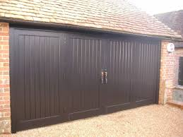 Bi fold | Folding wooden garage Doors | Tongue and Groove Boards ...