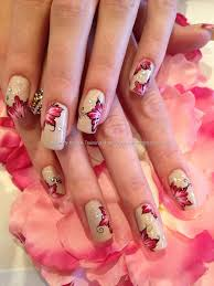 Freehand one stroke nail art. Beige with pink and black flowers ...