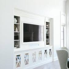 living room built ins with mirrored x front cabinet doors
