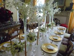 awesome design of dinner table decoration ideas showing white flower bouquet on tall glass vase
