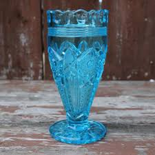light blue glass vase or goblet with daisy and on pattern vintage wedding decor