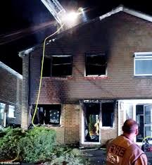 crews continued to hose down the blaze through the night as the family stayed with friends
