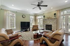 Cream Brick Fireplace Combined With Glass Windows On The Gray Wall Completed Brown Leather Sofa