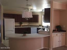 charming remodeled 2 bdrm 2 bath home plus a den offers new kitchen cabinets new counter tops includes all appliances plus new microwave