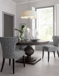 simple and clean design in this dining room makes the vibrant chair pattern pop even more