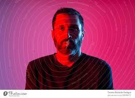 colorful studio portrait of a bearded