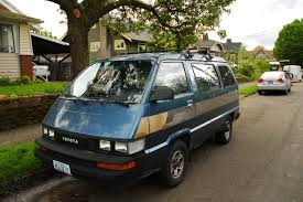 OLD PARKED CARS.: 1987 Toyota 4WD Van.