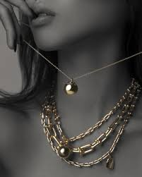 mae wears a tiffany hardwear wrap necklace layered with a tiffany hardwear ball pendant necklace and tiffany hardwear graduated link necklace