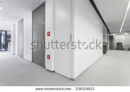 hallway office. interesting hallway corridor of business office with grey doors with hallway office