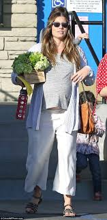 Jessica Biel looks fit to burst as she leaves birthday party at.