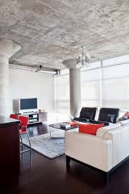 loft 001 example of a mid sized minimalist open concept living room design in toronto with beautiful living room pillar