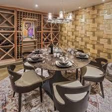 mountain style concrete floor and gray floor wine cellar photo in los angeles