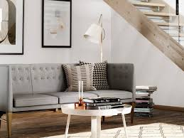 interior brown wooden scandinavian staircase connected grey fabric sofa with legs and round white table the rug awesome design shows modern look complete