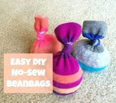 diy bean bag toss game for toddlers no sew beanbags your toddler will love bean how diy bean bag toss
