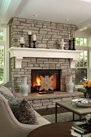 exposed stone fireplace mantel decorating ideas with white mantel combine black candle holder plus ceramic vase