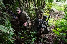 u s department of defense photo essay u s sailors crouch in the jungle during insertion and extraction training during southern partnership station 2014