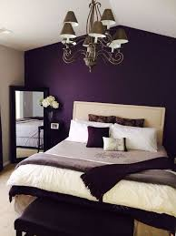 Deep purple accent wall Romantic Bedroom Design & Decor by Kelly Ann