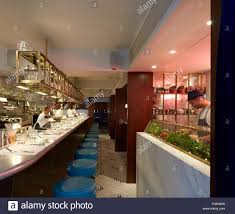Commercial Kitchen Design London Open Kitchen With Bar Counter Seating And Chefs At Work The