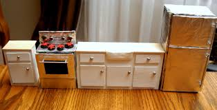 how to make doll furniture. aside from a faucet rug some open overhead shelving and accessories this room is done the stove fridge were made cardboard cabinets how to make doll furniture