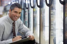 Hispanic Grocery Store Manager Holding Clipboard Stock Photo