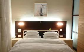 headboard lighting. Bedroom:Good Looking Bedroom Light Fixtures Ideas With Brown Wooden Headboard Also Cool Led Lighting N
