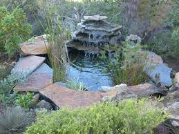 simple diy backyard garden house design with small ponds with stone border and waterfall ideas