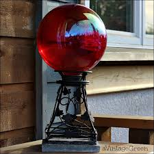 i don t know what the pretty red glass ball is called but it makes a lovely accessory update red gazing ball thanks friends