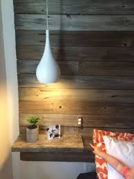 modern white bedside pendant lamps look contrasting with a reclaimed wood wall
