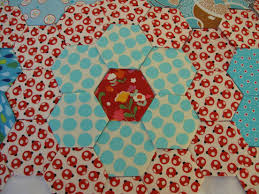 becrafted: Hexie Quilt in Progress & The center of the hexies and the background fabric are by Keiko. The aqua  fabrics are from my stash. I was a little worried that the background  fabric might ... Adamdwight.com