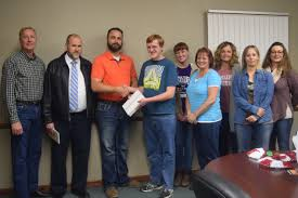 "smithgall wins annual success for teens essay contest south  cory jackson of jackson insurance agency third from left presents an ipad to kevin smithgall winner of the agency s ""success for teens"" essay contest"