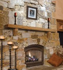 excellent stone stacked fireplace with rustic wood mantel and modern fire pit design ideas