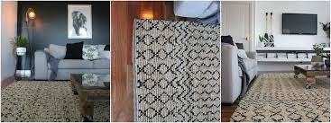 above is the nomad nature hand woven black and natural jute rug made from all natural hard wearing jute the nomad nature rug s delicate ethnic pattern