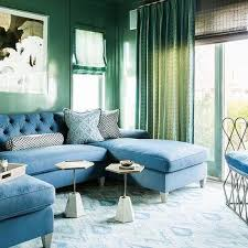 blue tufted sectional with green lacquered walls