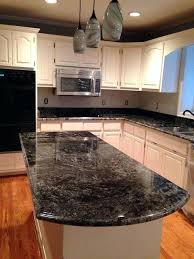 kitchens with dark countertops light cabinets with dark floors 1