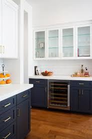 red oak wood cordovan amesbury door navy blue kitchen cabinets backsplash subway tile thermoplastic limestone countertops