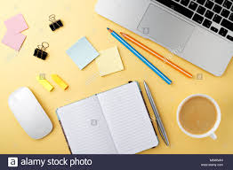 office desk work. Start Of Morning Work Office Desk With A Cup Coffee Computer Laptop Pencil Sheet Paper Notebook Pen Yellow Texture Table Business Concept Backgroun H