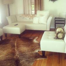 cowhide rug with white furniture