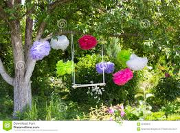 Paper Flower Branches The Swing And Colorful Paper Flowers Hanging On The Tree Stock Photo