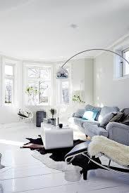 cowhide rug lay black white living room furniture floor lamp