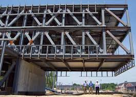 The 52-foot-long cantilever serves as a gateway into the new main part of  campus. The structural steel of the super truss was exposed on this face of  the ...