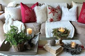 rustic farmhouse coffee table with festive touches and holiday pillows