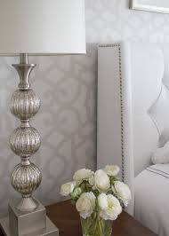 gorgeous tone on tone stenciling in a master bedroom
