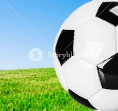 green grass football field. Traditional Black And White Football On The Field With Green Grass Background