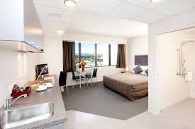 Small Apartment Bedrooms Stylsih White Themed Bedroom With Modern Bed Furniture On The Gray