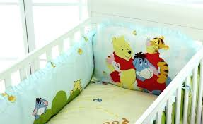winnie the pooh crib sheets image of the pooh nursery bedding cushions and blanket pink winnie