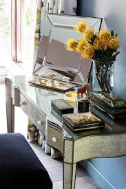 dressing station a faux reptile skin dressing table displays a selection of russian lacquer boxes lalique and daum glass next to a ralph lauren tray