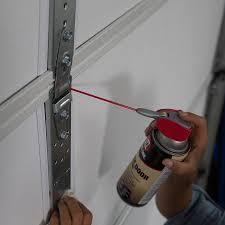 lubricating garage door hinges