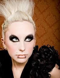 dark gothic eye makeup and blond hair