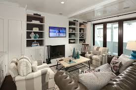 bookcases with glass doors living room beach with built in bookcase glass doors gray sofa recessed accent lighting family room