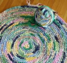 here s what i consider a much easier way to crochet a rug using fabric strips at least for me so i thought i would share